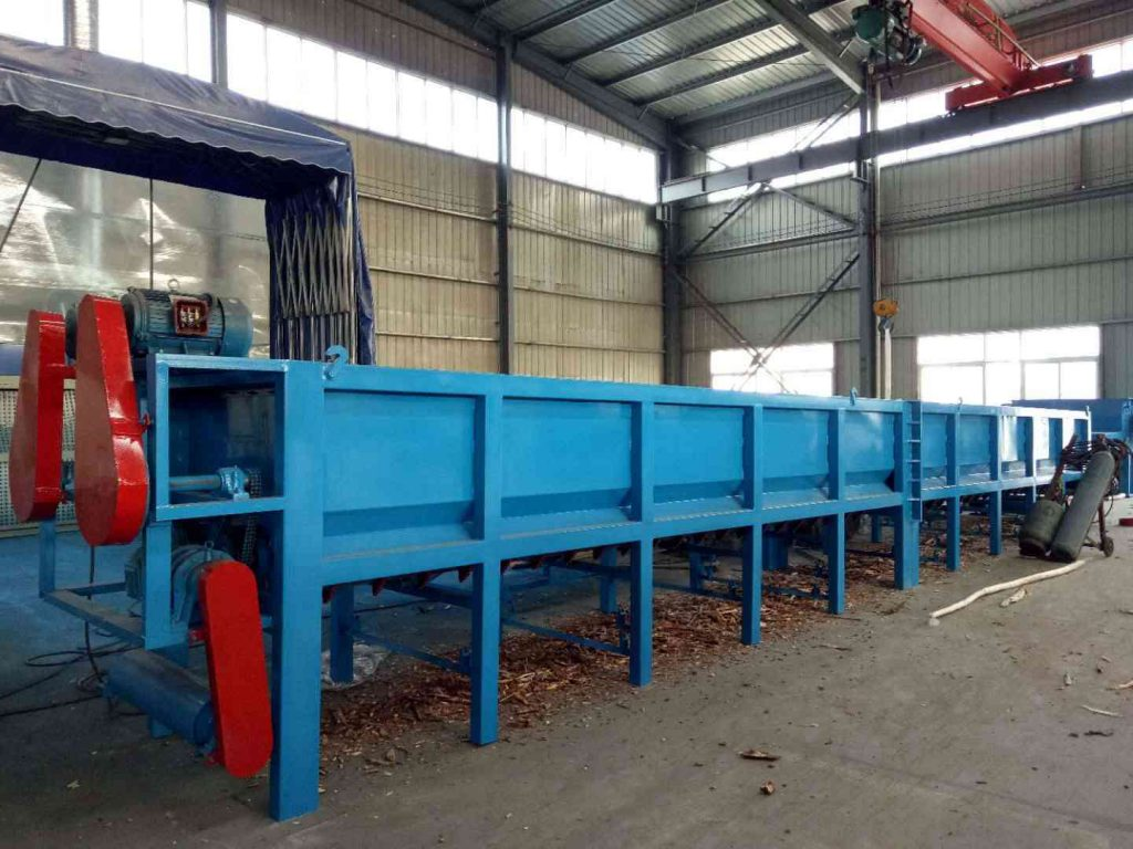 large wood debarker in the wood processing plant